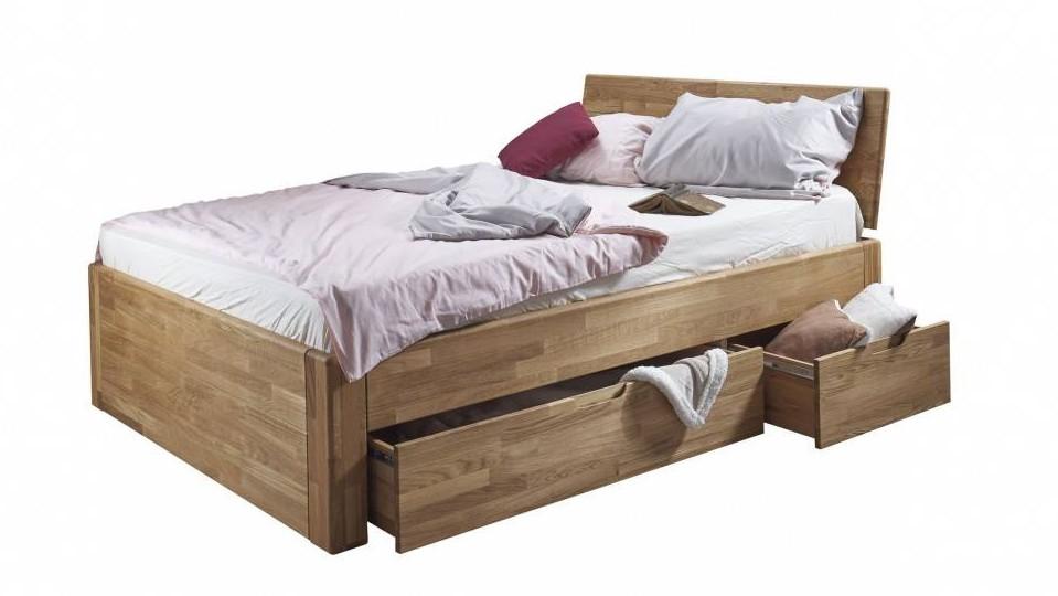 Masivna postelja s predali